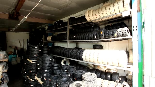 stock wheels and tires for forklift, warehouse, Industrial interior, stock wheels and tires for forklift video