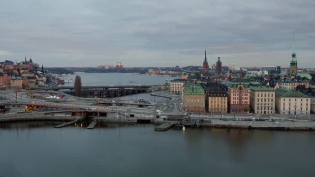 AERIAL: Stockholm city, Slussen and Old town The Swedish capital Stockholm from above and the famous buildings: Tyska kyrkan, Stadshuset, Riddarholmskyrkan stockholm stock videos & royalty-free footage