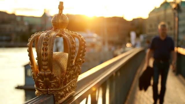 Stockholm, Sweden. Skeppsholmsbron - Skeppsholm Bridge With Its Famous Golden Crown In Stockholm, Sweden. Famous Popular Place Landmark Destination. Scandinavia Travel. Copy Space