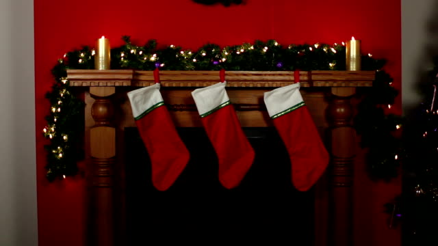 Stockings hung on Fireplace at Christmas - DOLLY Stock HD video clip footage of 3 Christmas stockings hung on the fireplace - Dolly motion christmas stocking stock videos & royalty-free footage