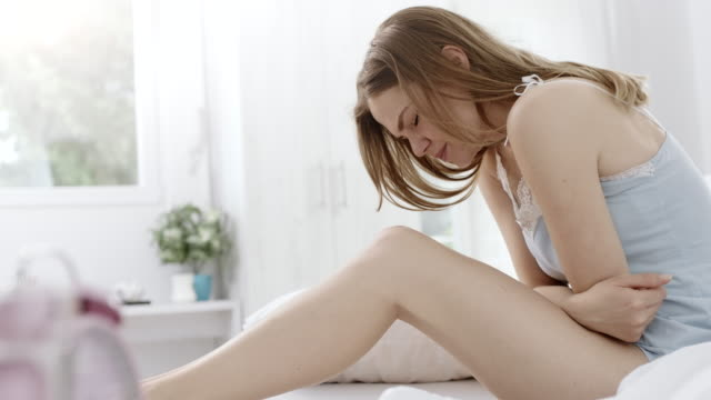 Stomachache Woman suffering stomach pain pain stock videos & royalty-free footage