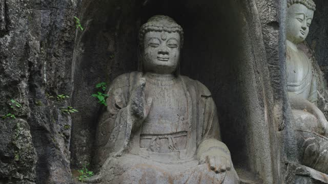 Stone buddha statue in grotto at Lingyin Temple,Hangzhou,China.