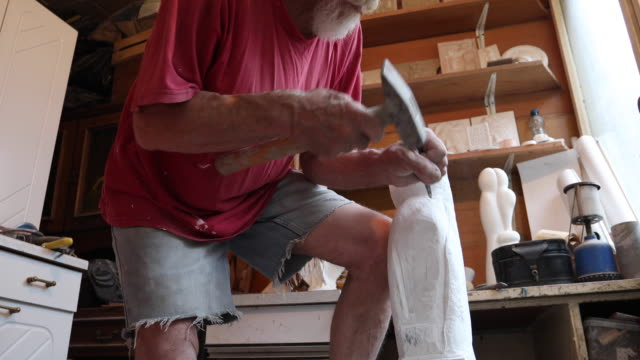 Stone carver working on a piece