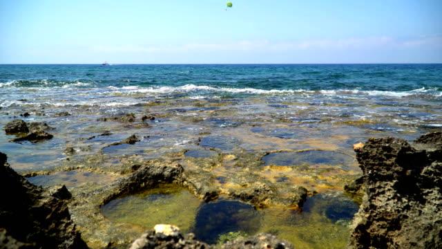 stone coastal caves on the edge of a rocky Mediterranean coast