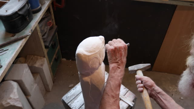 Stone cutter at craft workshop