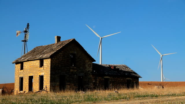 Stone House Old New Wind Turbines Blowing video