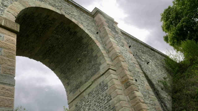 Stone railway arch bridge, high old viaduct. Transport construction, historical architecture video