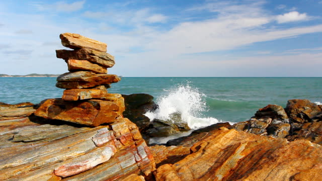 Stone stack stable and wave splash on background at Khao Laem Ya video