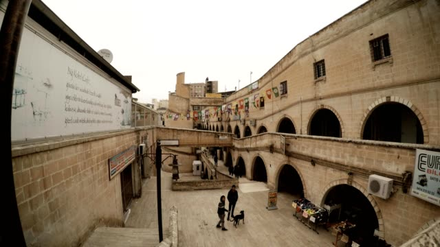 Stone Streets on Place of Old Canal Quaint Form Stairs People Walk Boy with Dog Sanliurfa video