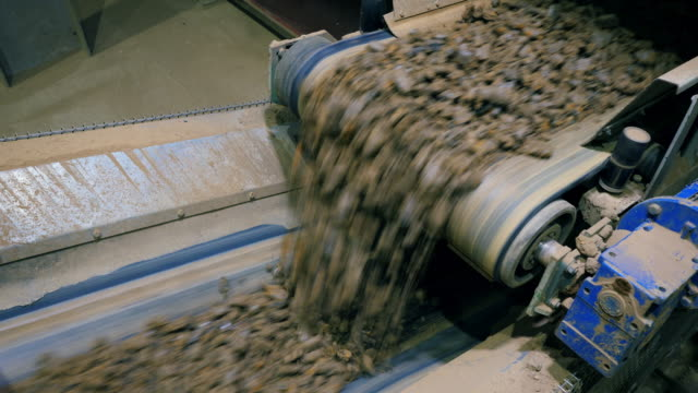 Stones falling from a working conveyor at a factory. Stones falling from a working conveyor at a factory. 4K conveyor belt stock videos & royalty-free footage