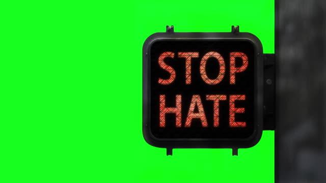 Stop Hate. Have Hope—Medium shot of Walk Signal on Chroma Key with hopeful social message