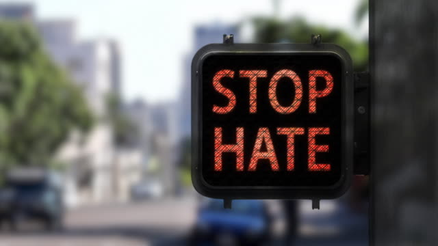 Stop Hate. Have Hope—Medium shot of Walk Signal with hopeful social message