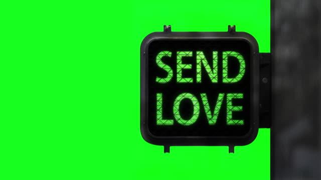Stop Hate. Send Love—Medium shot of Walk Signal on Chroma Key with hopeful social message