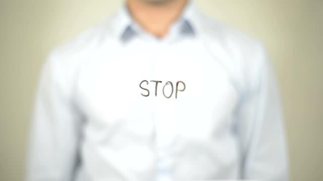 Stop, Man Writing on Transparent Screen video