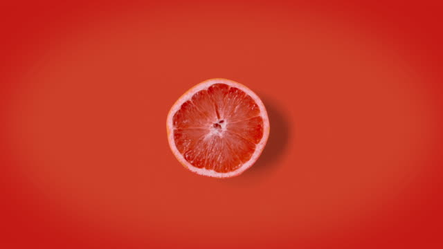 Stop motion animation graprefruits woggling or dancing. Texture or minimal animation.