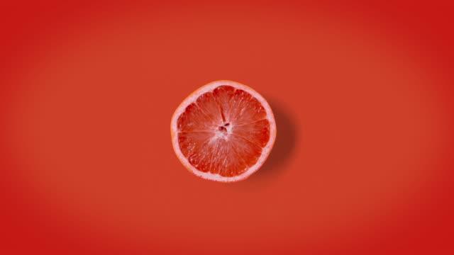 vidéos et rushes de stop motion animation graprefruits vaciller ou danser. texture ou animation minimale. - pamplemousse