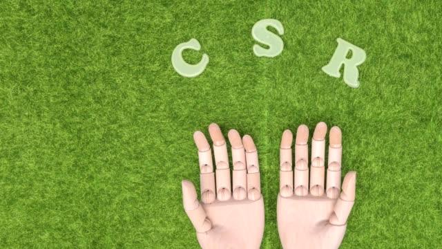 stop motion animation. grünes gras hölzerne hände mit csr, corporate social responsibility - verantwortung stock-videos und b-roll-filmmaterial