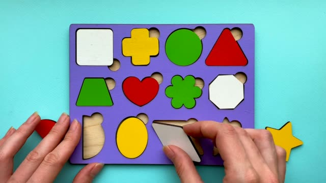 Stop motion animation how an educational toy consisting of geometric shapes is disassembled. Childrens development, toys.