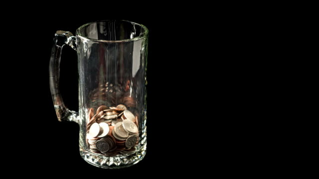 Stop Motion Animation of Coins Filling Beer Mug