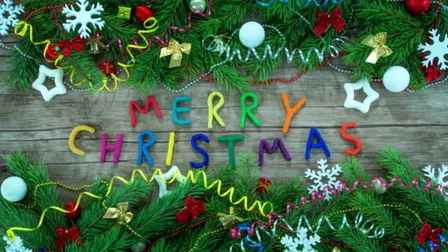 animazione stop motion di merry christmas lettering - christmas movie video stock e b–roll