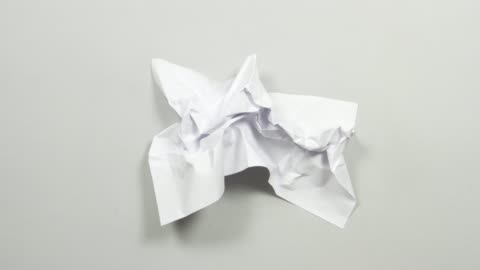 stop motion animation paper wrinkles making a paper ball and disappears. intro, outro, transition. Seamless loop. Sheet of paper wrinkles. creativity stock videos & royalty-free footage