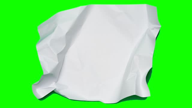 Stop motion animation paper wrinkles making a paper ball. Mint green background