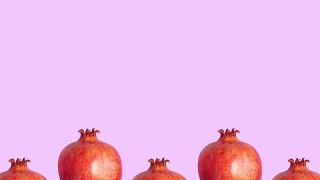 Stop motion animation Ripe red pomegranates move in the form of a wave on a pink background copy space for text Stop motion animation Ripe red pomegranates move in the form of a wave on a pink background copy space for text juicy stock videos & royalty-free footage