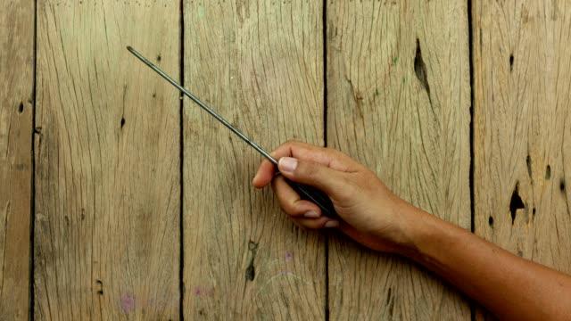 stop motion animation set of tools on wooden background - narzędzie do pracy filmów i materiałów b-roll