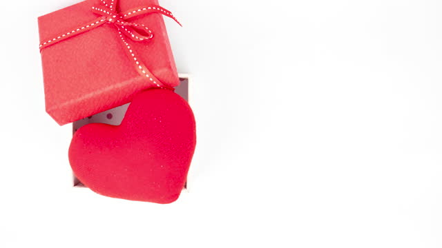 Stop motion animation The heart coming out of the gift box on white background. Stop motion animation The heart coming out of the gift box on white background. world health day stock videos & royalty-free footage