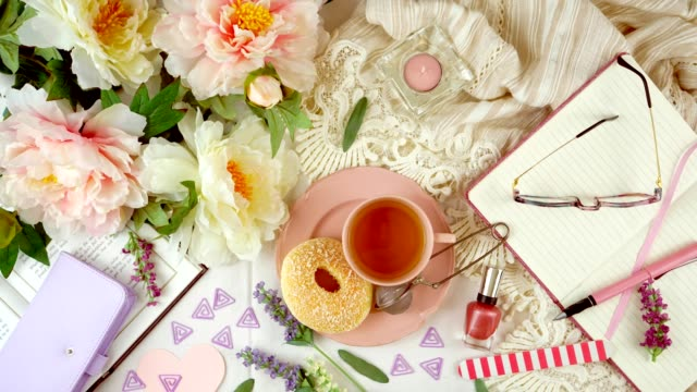 Stop motion animation timelapse of feminine leisure and relaxation flatlay.