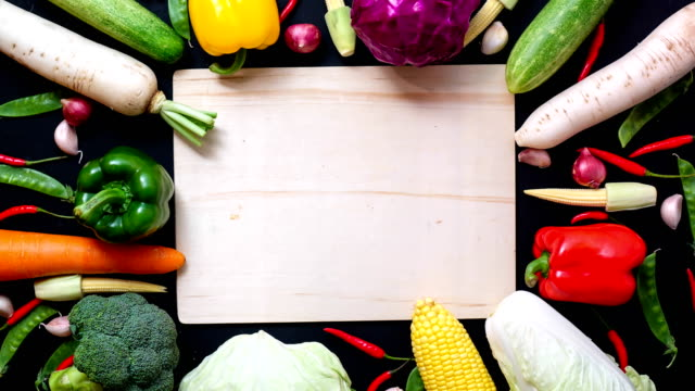 Stop motion animation top view vegetables and wood background for copy space video