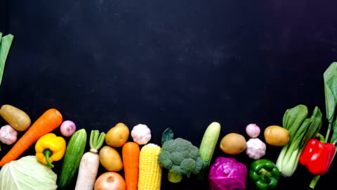 stop motion animation top view vegetables on black color background for copy space stop motion animation top view vegetables on black color background for copy space ,4K video fruit stock videos & royalty-free footage