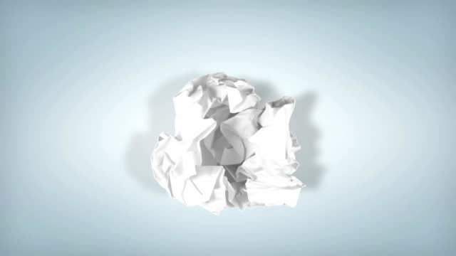 Stop motion animation: Unwrapping and wrapping blank sheet of paper. In and out. Luma matte included.