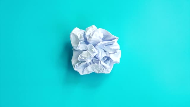 Stop motion animation with white paper crumpled on blue sky background