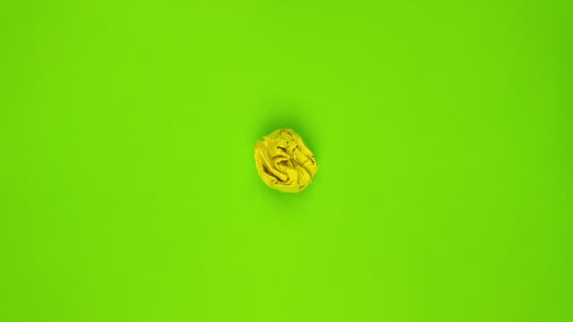 Stop motion animation. Yellow and green paper