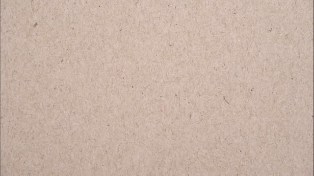 stop motion brown paper animation texture . 4k 3840 × 2160 video footage