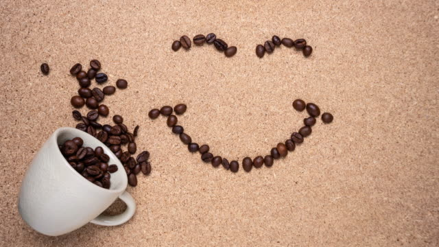 Stop motion Coffee beans move in a smile shape. The concept of happiness when drinking coffee.
