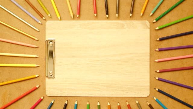 stop motion color pencil on wood backgroud , 4k video - matita colorata video stock e b–roll