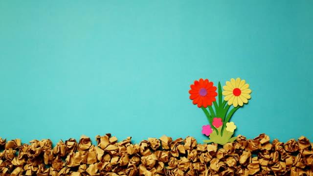 stop motion flower growing with paper cut , 4k video - kwiat roślina filmów i materiałów b-roll