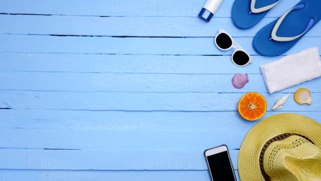 stop motion - objects on a beach on blue background. holiday or  vacation time