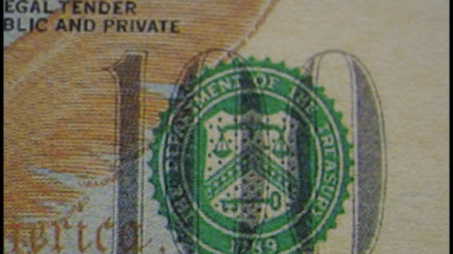 Stop motion of close-up dollar banknote - video