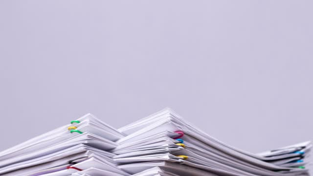 4K Stop motion of close-up stack overload document report paper with paperclip place decrease on white background, business and education concept footage paperless used. 4K Stop motion of close-up stack overload document report paper with paperclip place decrease on white background, business and education concept footage paperless used. heap stock videos & royalty-free footage