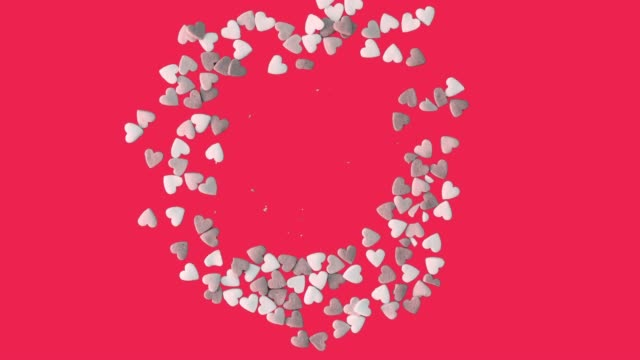 Stop Motion of Heart Sprinkles on red background