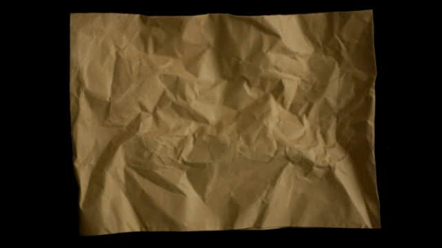 vídeos de stock e filmes b-roll de hd-stop motion papel - amarrotado