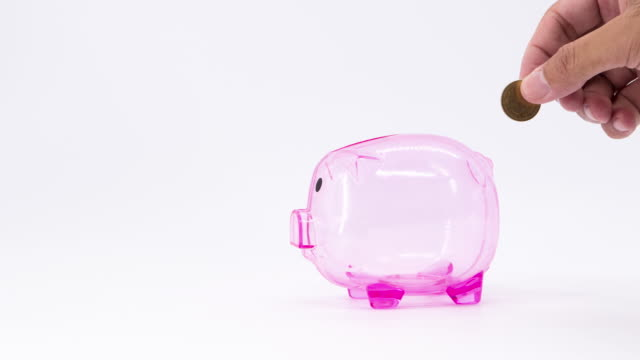 Stop motion shot of Putting coins in a piggy bank isolated on white background. Saving Money concept.