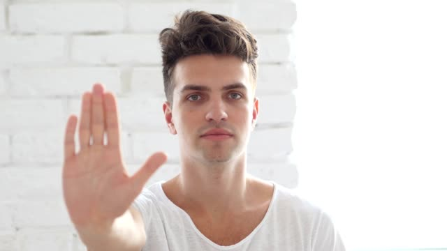 Stop Sign, Young Man Gesturing with Hand video