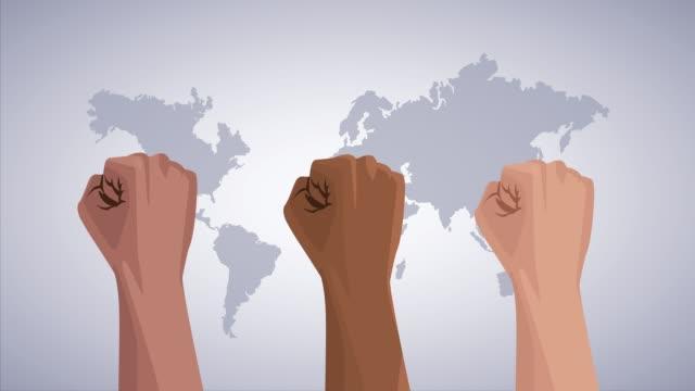 手の拳と地球地図で人種差別運動を止める - 拳 イラスト点の映像素材/bロール