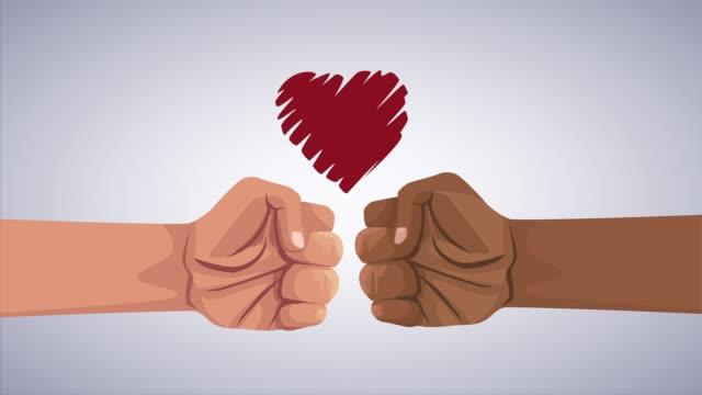 手の拳と心で人種差別運動を止める - 拳 イラスト点の映像素材/bロール