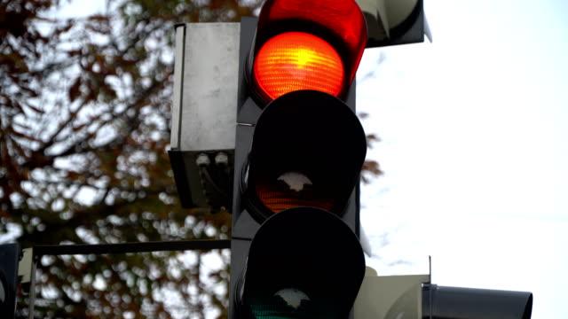 Stoplight. Traffic lights work in a big city at a crossroads.