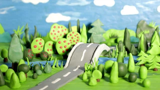 animation stopmotion avec voiture de pâte à modeler rouge - Vidéo